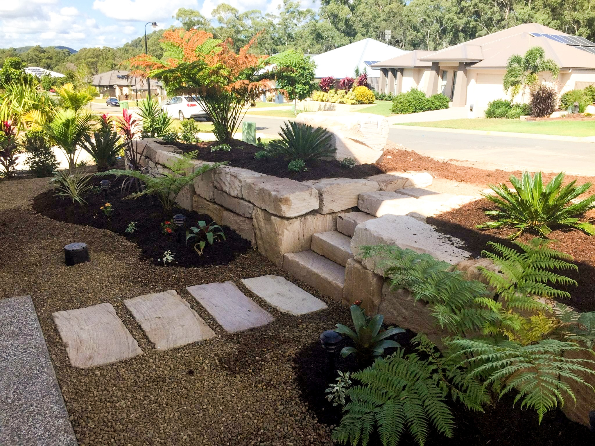 A example of c-grande sandstone rock with steps and steppers | Stone Creek Estate, Upper Coomera