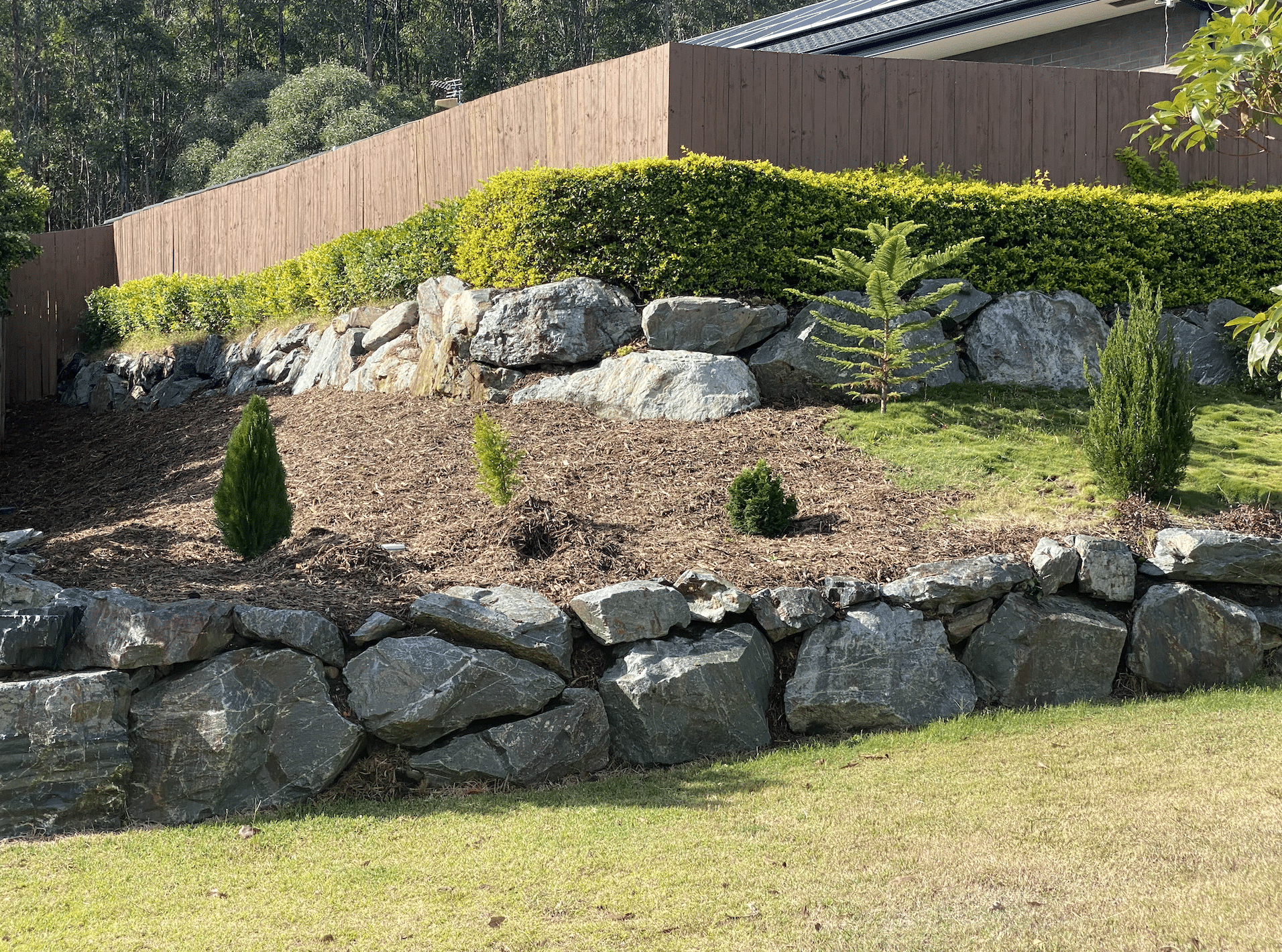 Blue metal rock wall, quarried basalt retaining wall Gold Coast
