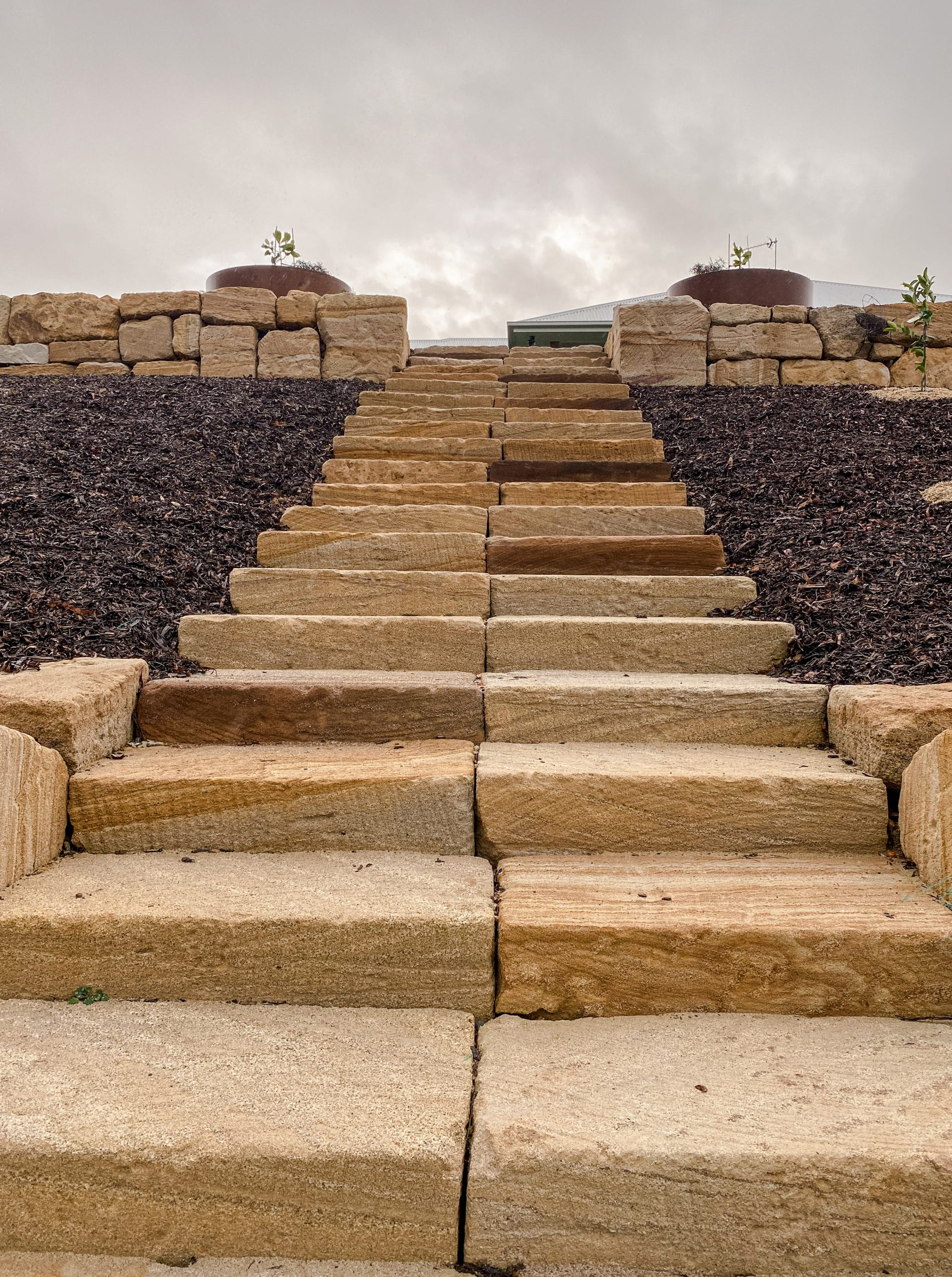 Sandstone steps Gold Coast - rough sawn sandstone steps with C grade sandstone rock wall, retaining wall Gold Coast