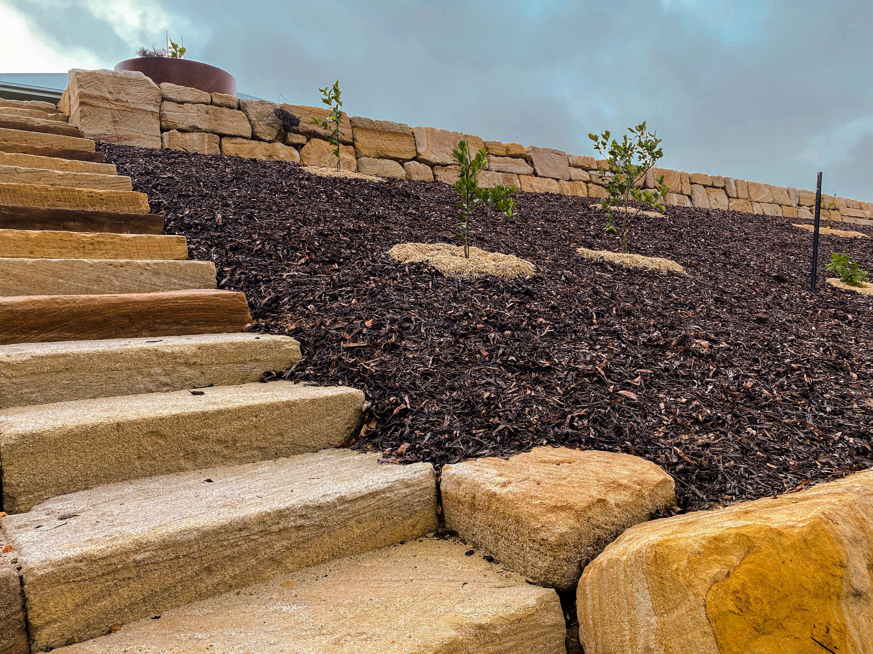 C grade sandstone retaining wall, rough sawn sandstone steps, rock wall Gold Coast