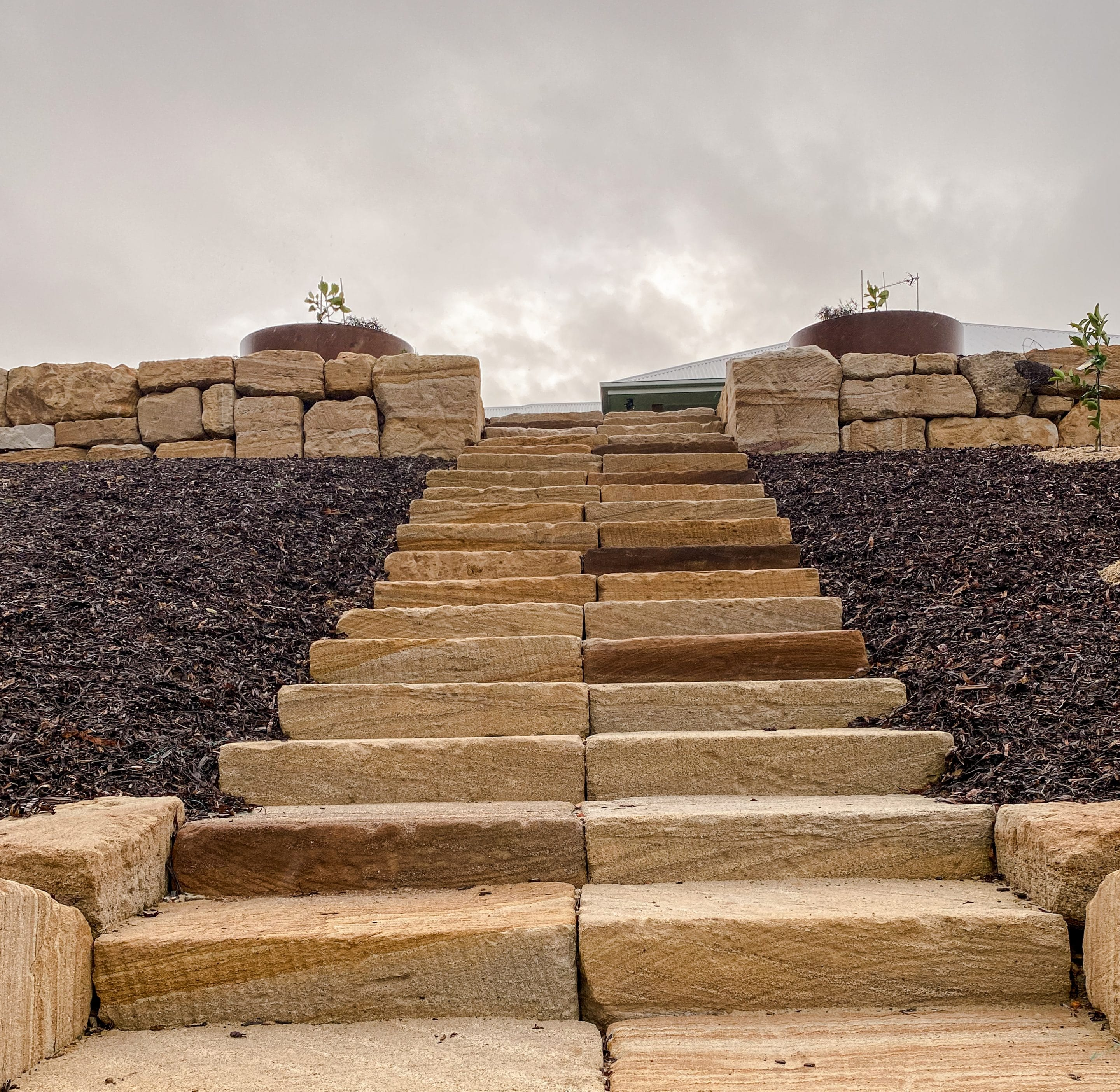 Rough sawn sandstone steps + C grade sandstone rock wall Gold Coast