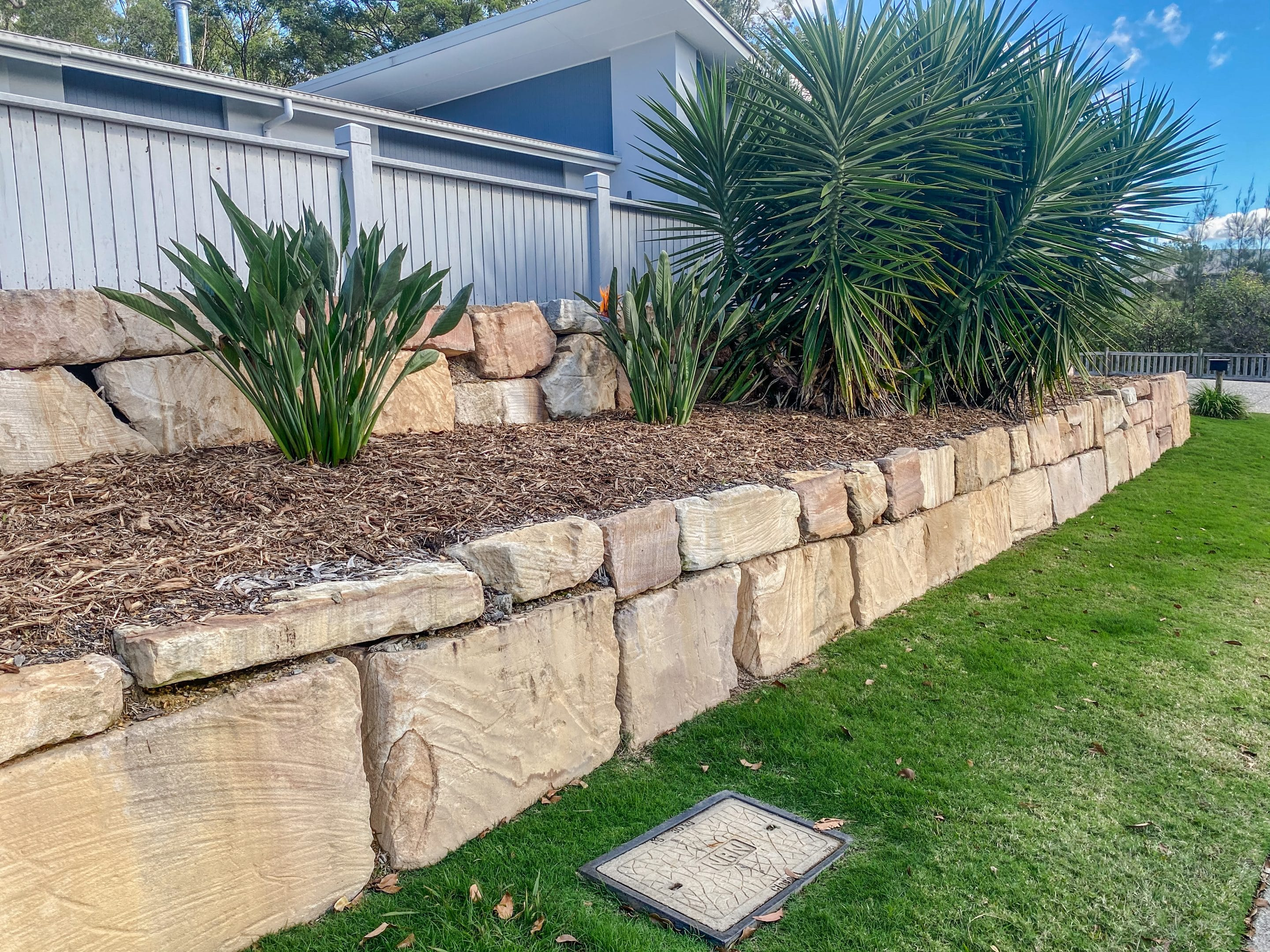 C grade sandstone retaining wall Gold Coast - two tiered rock wall