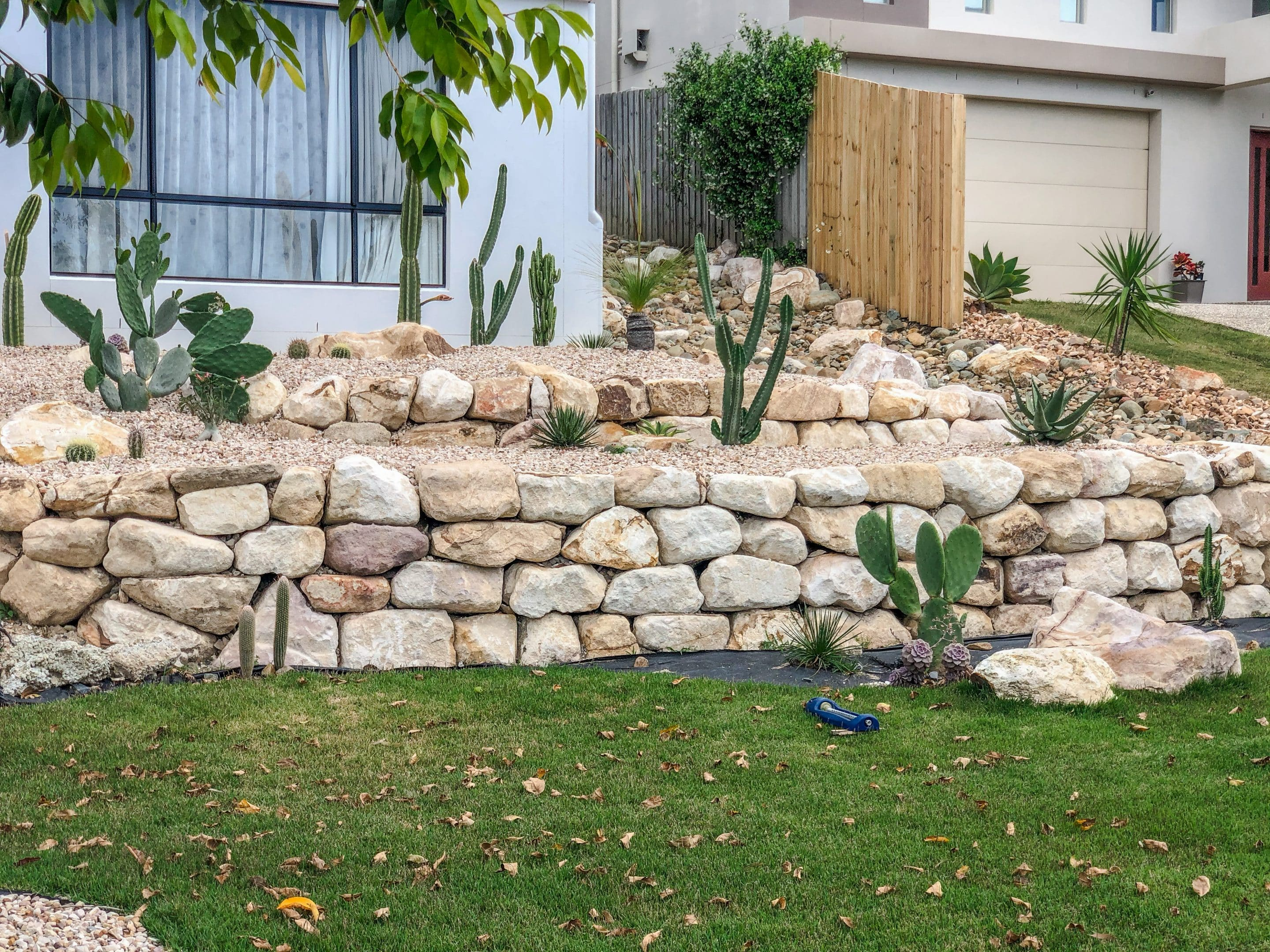 random sandstone retaining wall, Cactus and rock bed